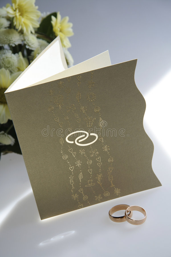 Wedding invitation and rings. Picture of wedding invitation and rings royalty free stock photos