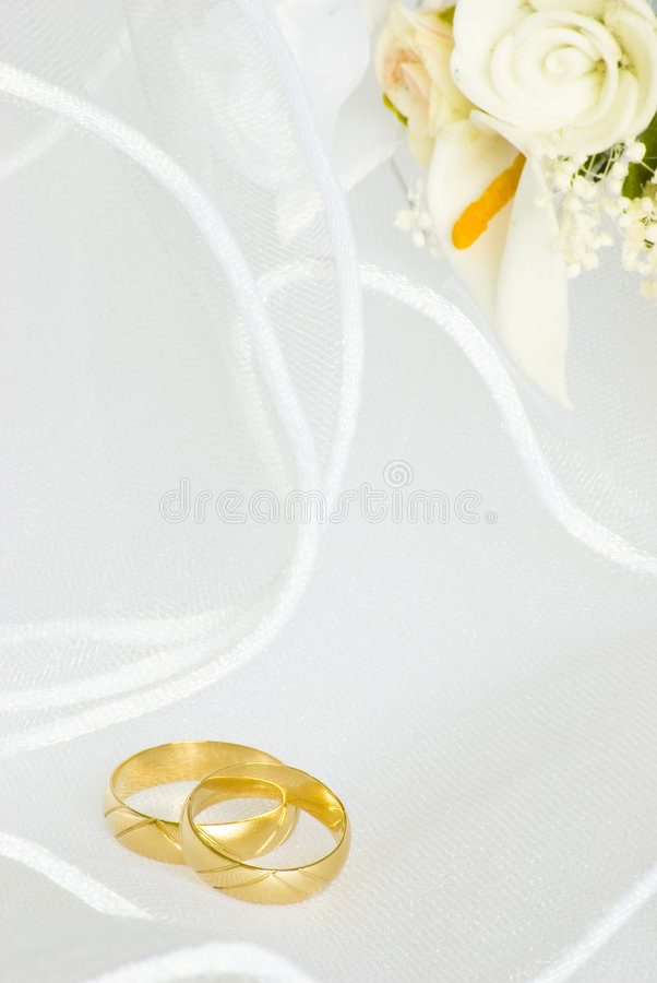 Free Wedding Invitation - Rings And Flowers Over Veil Stock Photos - 9245943