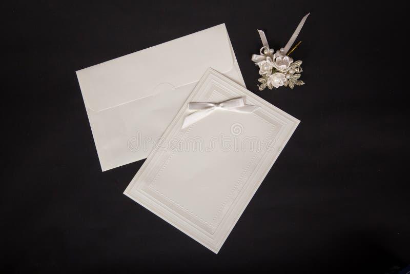 Wedding invitations on black blackground. Wedding invitations black background. Home made royalty free stock photo