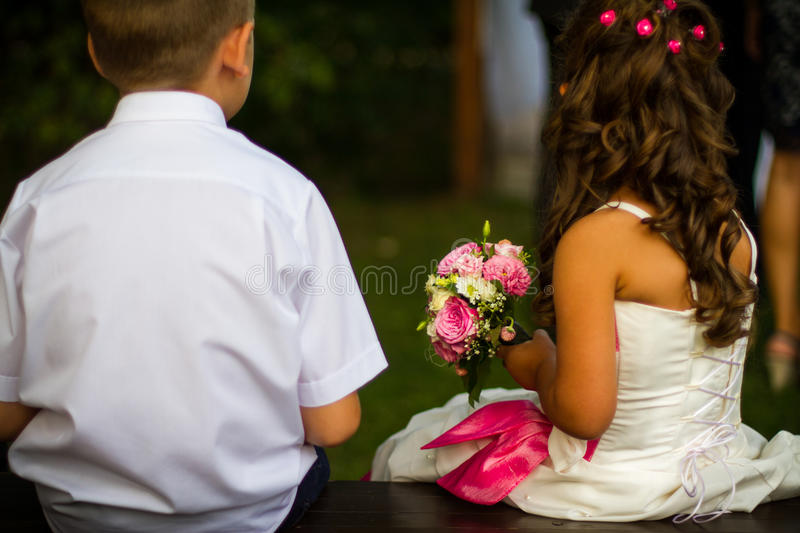 Wedding kids with rose bouquet. Cute weeding concept. Kids with roses stock photography