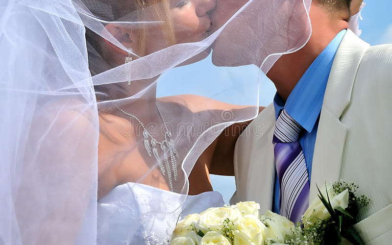 Wedding kiss stock photography