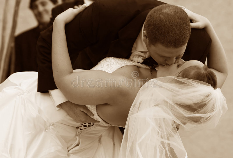 The wedding kiss. At a traditional ceremony in the united states