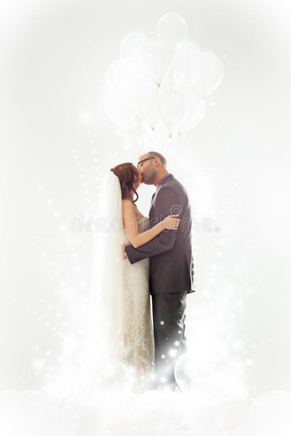 Wedding Kiss. Bride and groom kissing on their wedding day stock images
