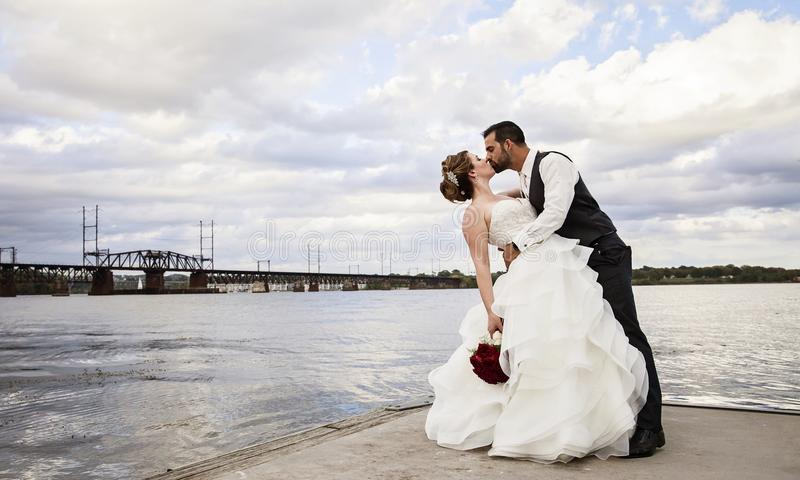 Wedding kiss on dock royalty free stock photo