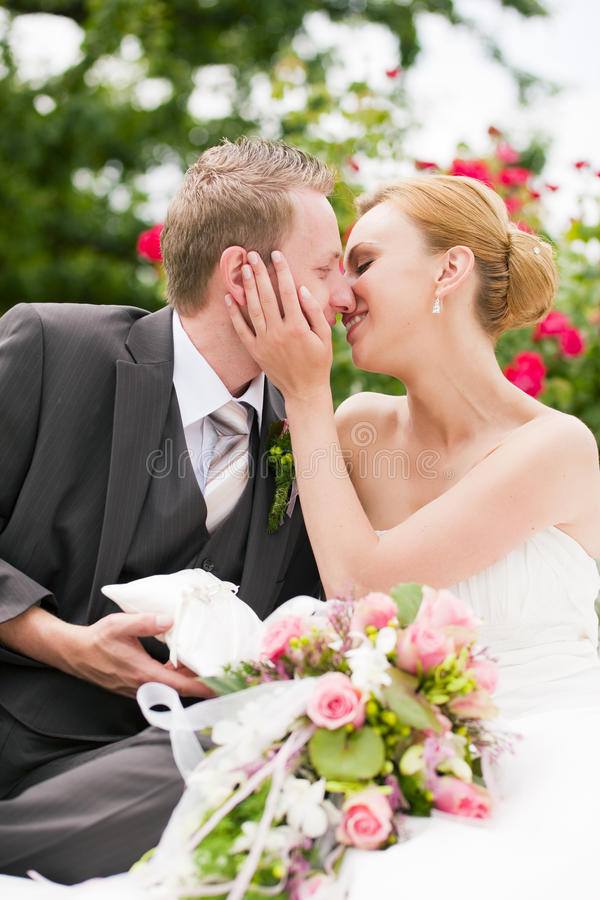 Wedding - kissing in park royalty free stock photo