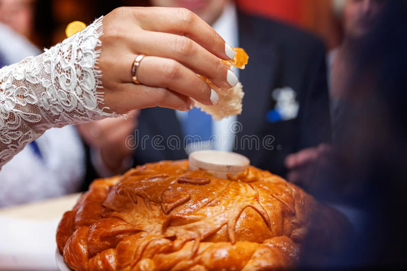 Loaf and salt at wedding. Wedding loaf being broken by bride and groom royalty free stock photography