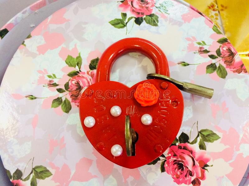 The red lock is on the flower box (gift) stock photography