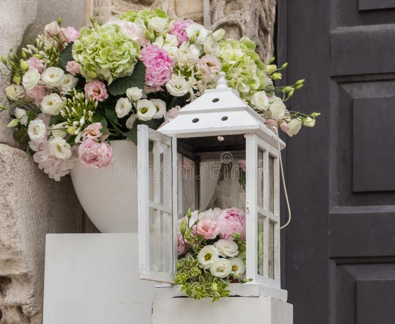 Wedding and marriage decoration. White boxes with flowers outside. Elegant bouquet. Arrangement and romance background. stock photos