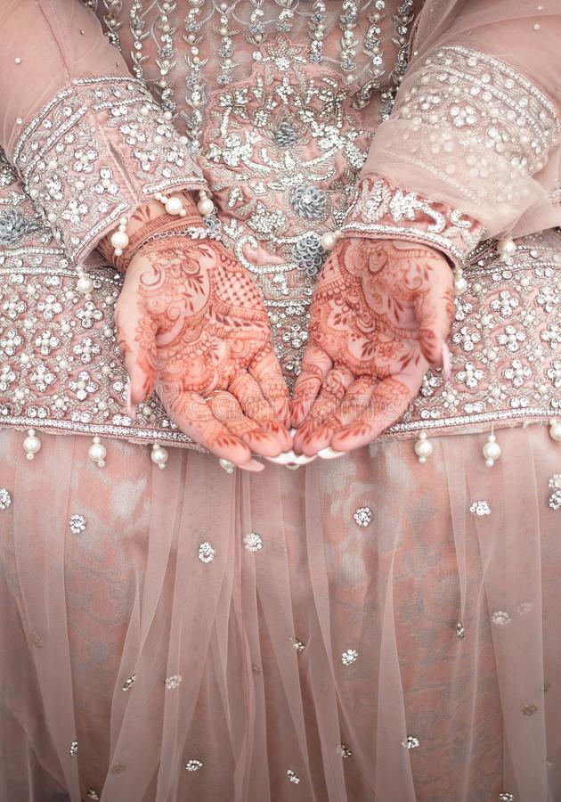Wedding Mehndi on bride`s hands. Mehndi is a form of body art originating from the Arabian peninsula, in which decorative designs are created on a person`s body royalty free stock photo