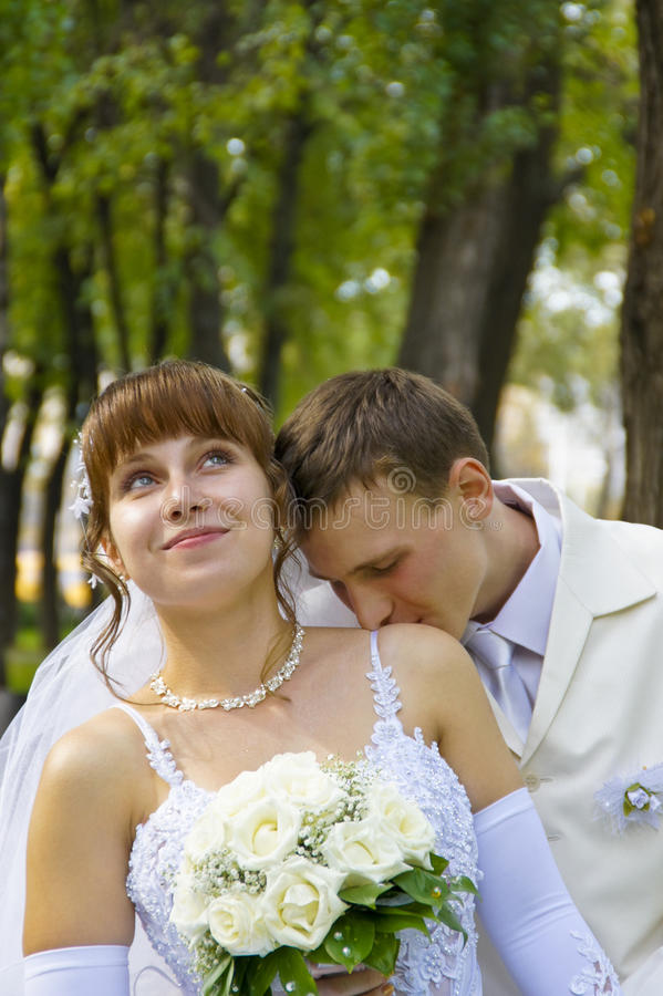 Wedding, the newlyweds. Beautiful bride and groom during a wedding a walk around the city stock image