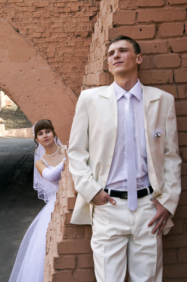 Wedding, the newlyweds. Beautiful bride and groom during a wedding a walk around the city royalty free stock photo