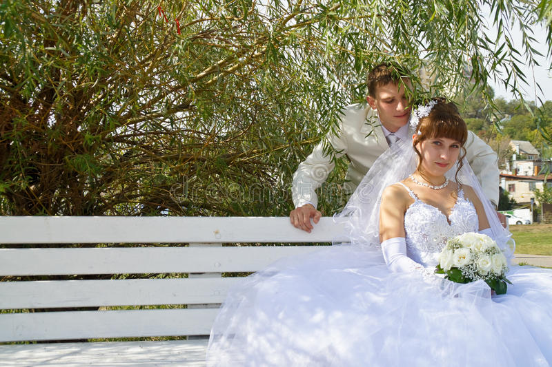 Wedding, the newlyweds. Beautiful bride and groom during a wedding a walk around the city royalty free stock images