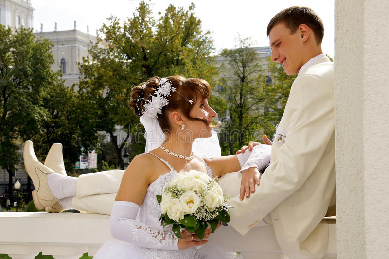 Wedding, the newlyweds. Beautiful bride and groom during a wedding a walk around the city royalty free stock photos