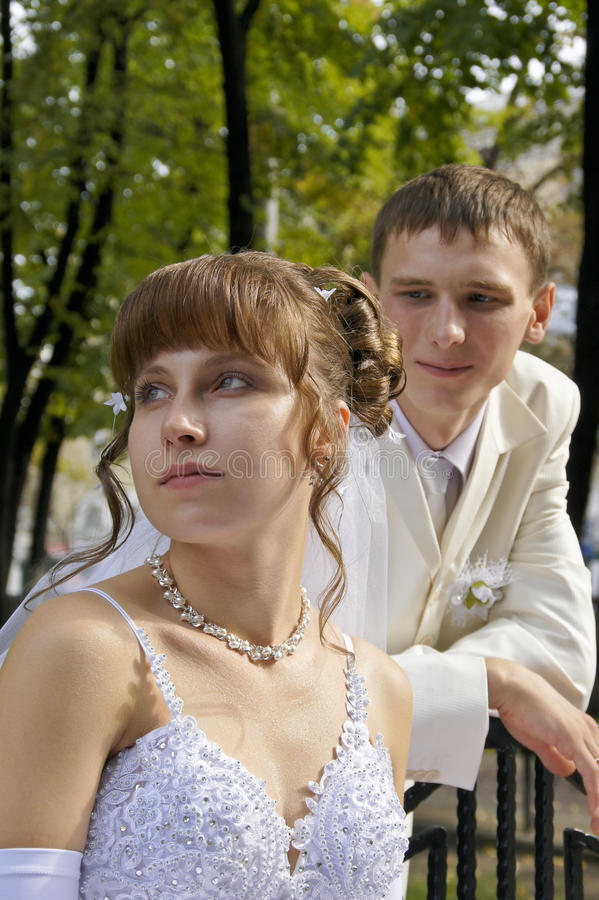 Wedding, the newlyweds. Beautiful bride and groom during a wedding a walk around the city royalty free stock photography