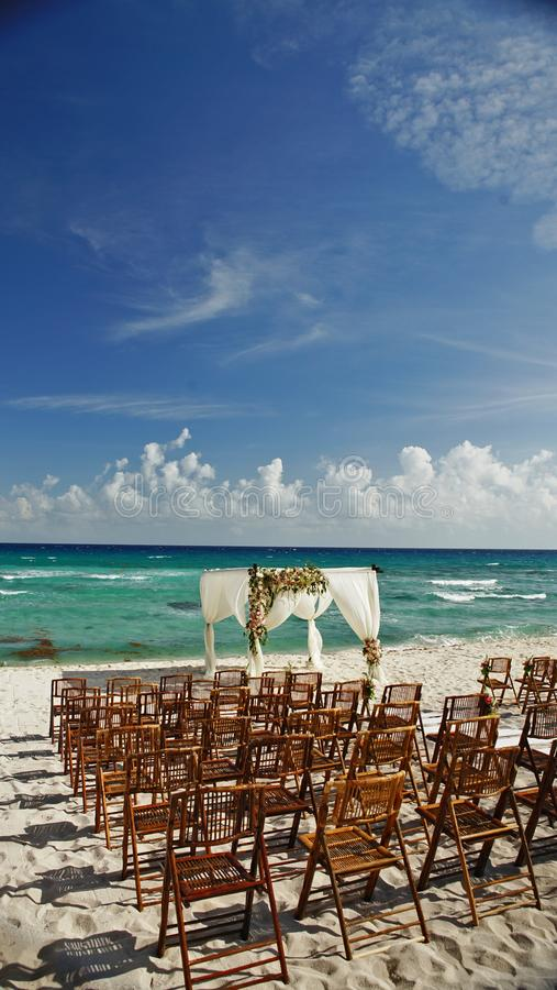 Wedding by the ocean in Cancun Mexico. Destination wedding in Cancun Mexico by the beautiful blue ocean royalty free stock image