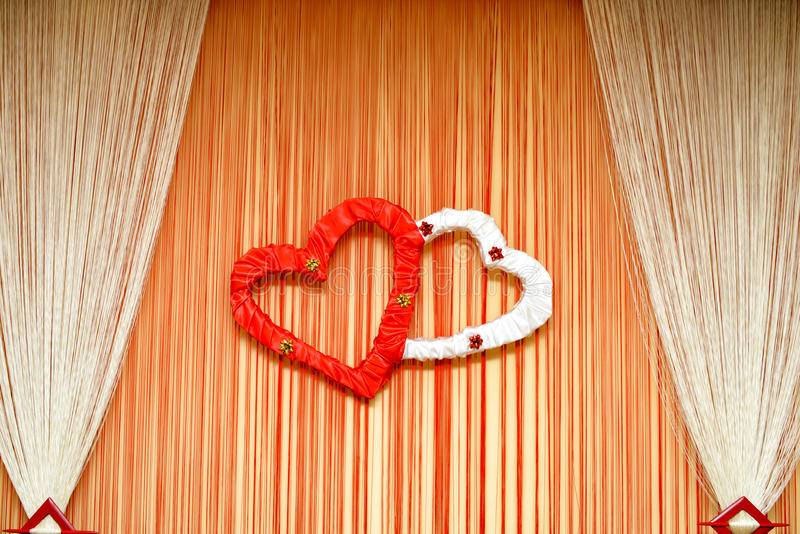 Wedding ornament with hearts and curtain. details stock photo