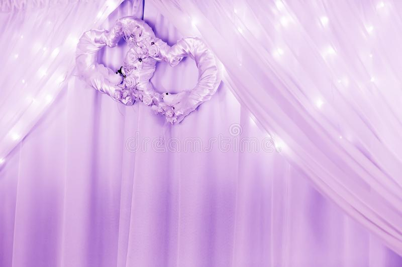 Wedding ornament with two hearts and curtain and lights. royalty free stock photography