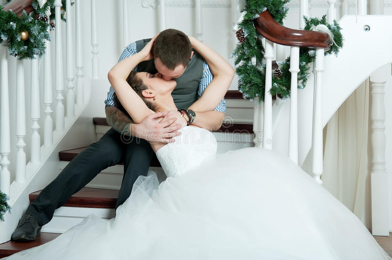 Indoor Wedding Venue Royalty Free Stock Photo: Wedding Pair, Kiss On Stairs. Veil. Indoor Stock Image