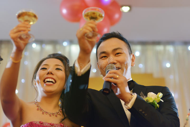 Wedding party champagne toasting. Natural candid photo Asian Chinese wedding dinner reception, bride and groom champagne toasting royalty free stock images