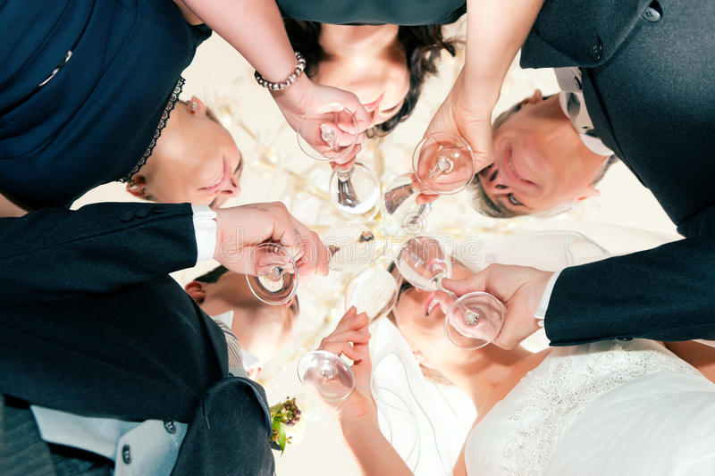 Wedding party clinking glasses stock image