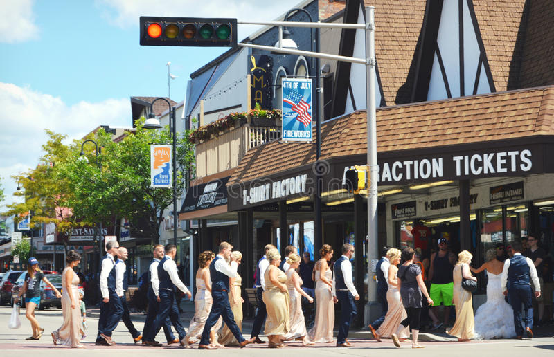 Wedding Party Crossing Road. A wedding party crossing the street under a stoplight at the Wisconsin Dells tourist destination royalty free stock photos