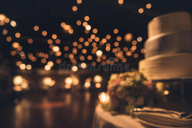 Wedding party evening. Blurred dance floor and wedding cake. royalty free stock images