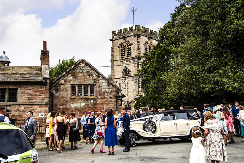 Wedding Party at Nether Alderley Parish Church in Cheshire stock image