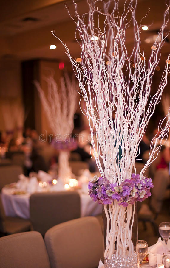 Wedding party table. Flower and stick arrangement on a table for a party or wedding reception royalty free stock photos