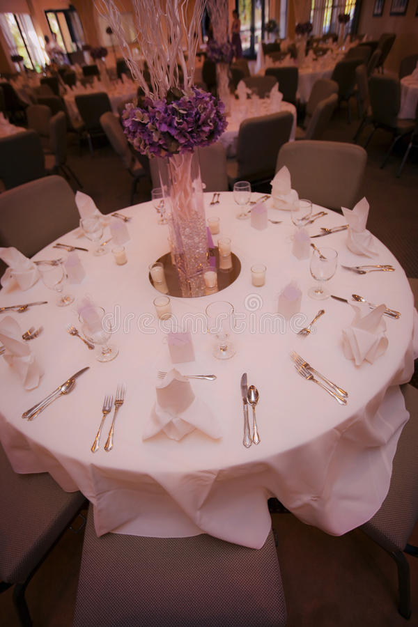 Wedding party table. Flower and stick arrangement on a table for a party or wedding reception royalty free stock image