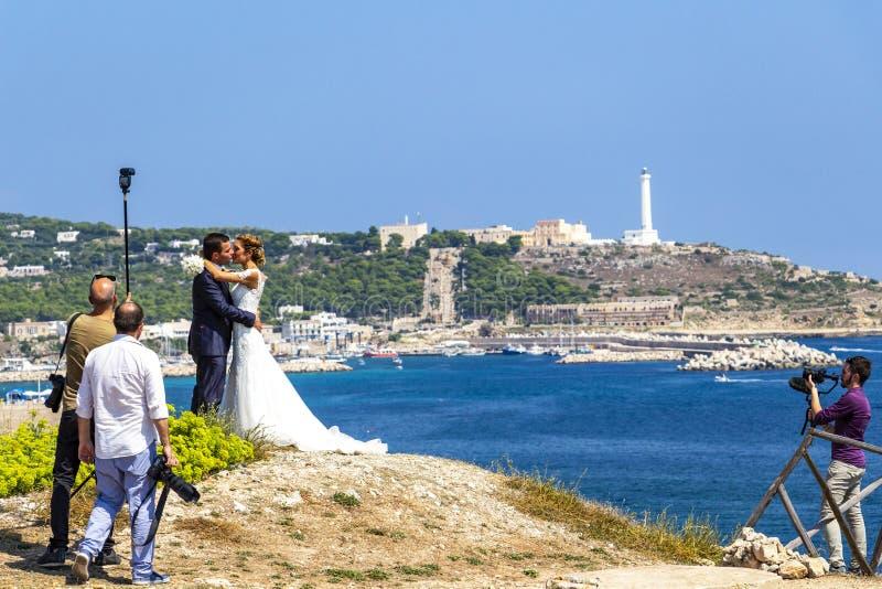 Wedding photo session at Punta Ristola, Italy. SANTA MARIA DI LEUCA, ITALY - AUGUST 31, 2018: Wedding photo session at Punta Ristola, Santa Maria di Leuca in the stock images