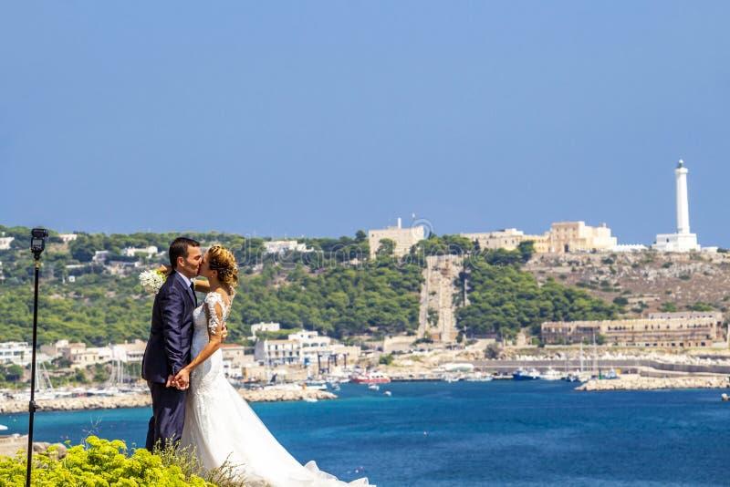 Wedding photo session at Punta Ristola, Italy. SANTA MARIA DI LEUCA, ITALY - AUGUST 31, 2018: Wedding photo session at Punta Ristola, Santa Maria di Leuca in the stock photography