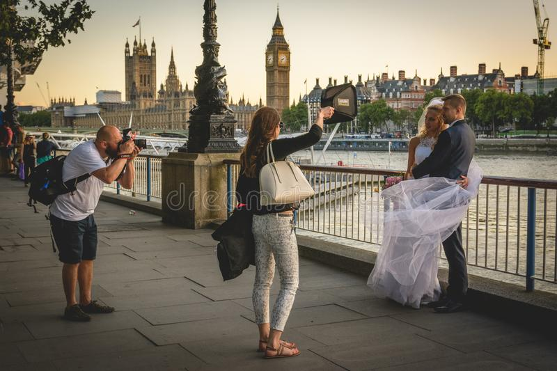 Wedding photo shooting on the South Bank in London UK. July 2017 royalty free stock photography