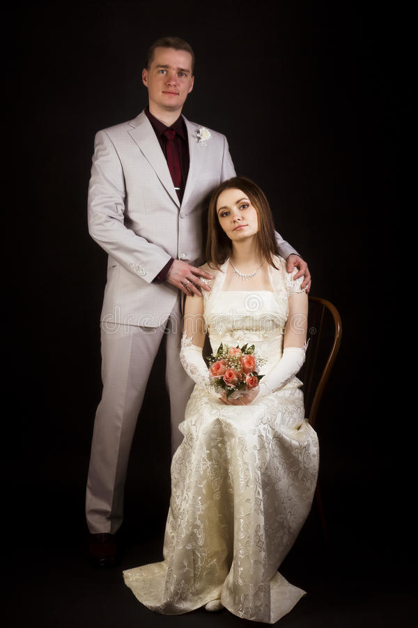 Wedding photo. Young beautiful couple on a black background. royalty free stock photos