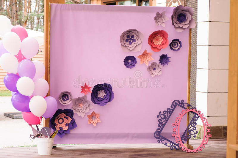 Wedding photo zone hand made wedding decorations stock image beautiful unusual wedding decor wall fabric and paper with colorful flowers balloons white and pink and purple colors in the photo area junglespirit Gallery