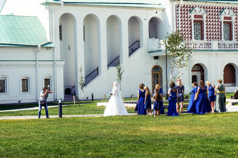 Wedding photographer takes a picture of a bride in the russian New Jerusalem monastery royalty free stock images