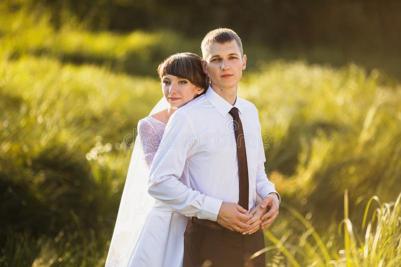Wedding photography. Happy family. Groom and bride in a white dress on a background of nature. Wedding photography. Happy family stock photo