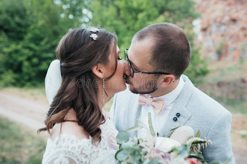 Wedding photography kiss bride and groom in different locations stock image