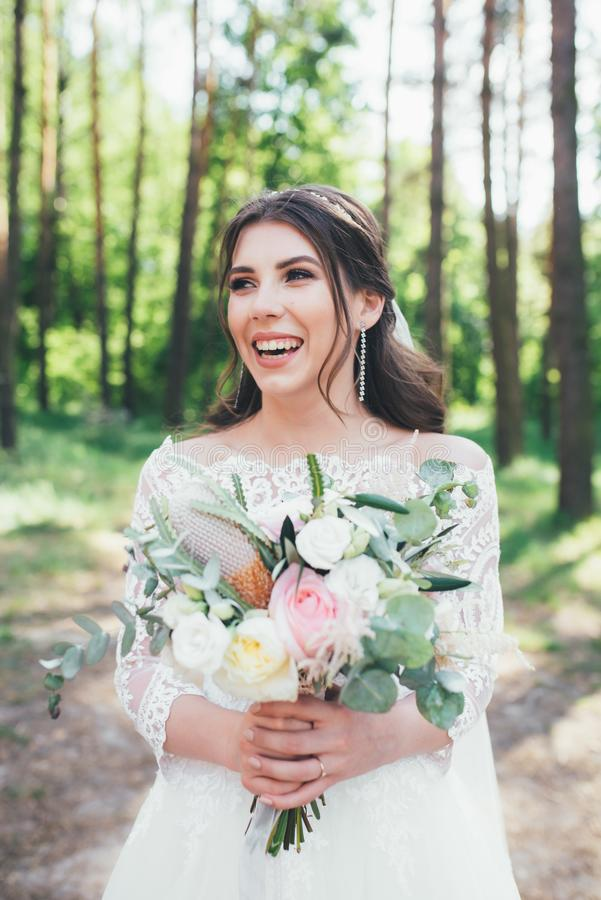 Wedding photography in rustic style emotions of the bride on the nature on the rocks.  royalty free stock images
