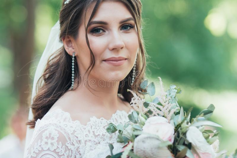 Wedding photography in rustic style emotions of the bride on the nature on the rocks.  stock photo