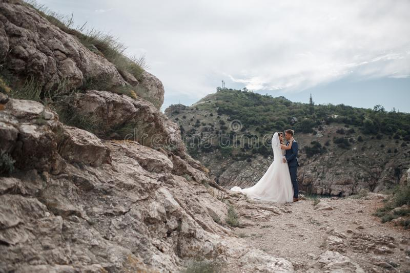 Wedding photography of a young couple, the bride and groom in a mountainous area in summer stock photo