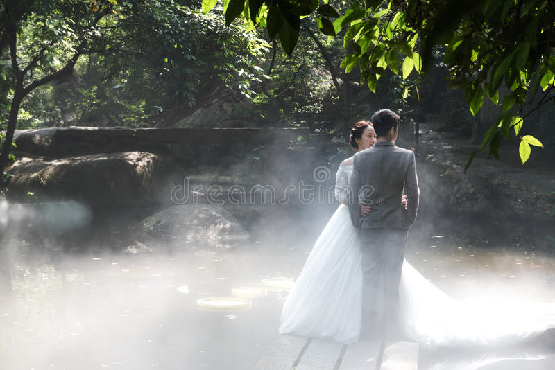 Wedding Photos in Fog. Two young men were taking wedding photographs with mist background stock photos