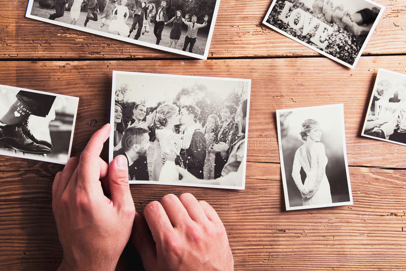 Wedding photos. Laid on a table. Studio shot on wooden background royalty free stock images