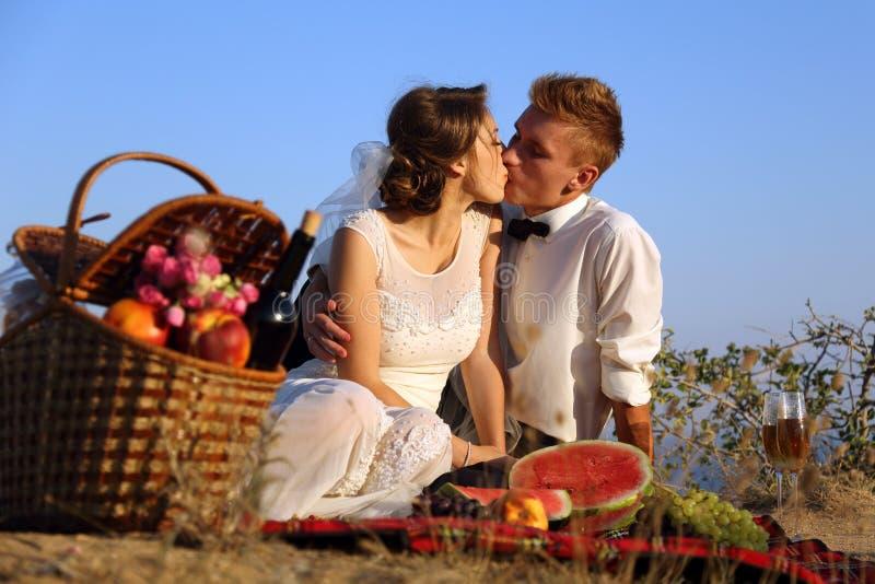 Wedding picnic on the coast. Wedding picnic on the beautiful mountain Coast royalty free stock image