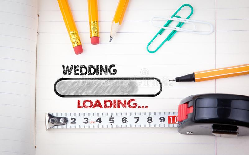Wedding Planner Notebook. pencils, pen and tape measure on a paper background royalty free stock photography