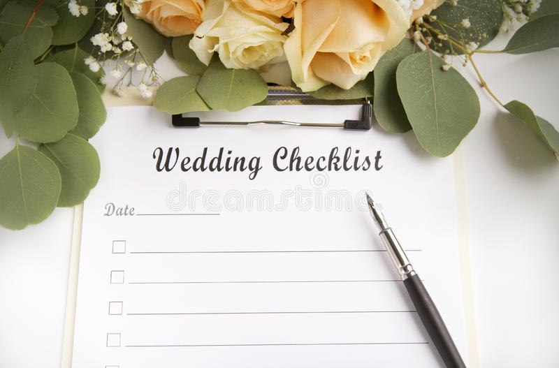 Wedding planning checklist with blank space and roses stock photos