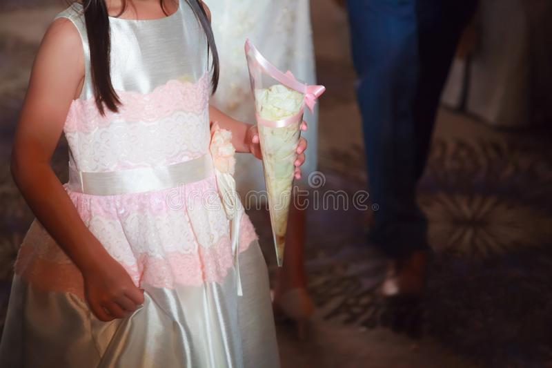 Wedding Reception and Bridal Party Romantic Decorating Accessories, Fresh White Rose Flower Petals in Scatter Confetti Cone for stock images
