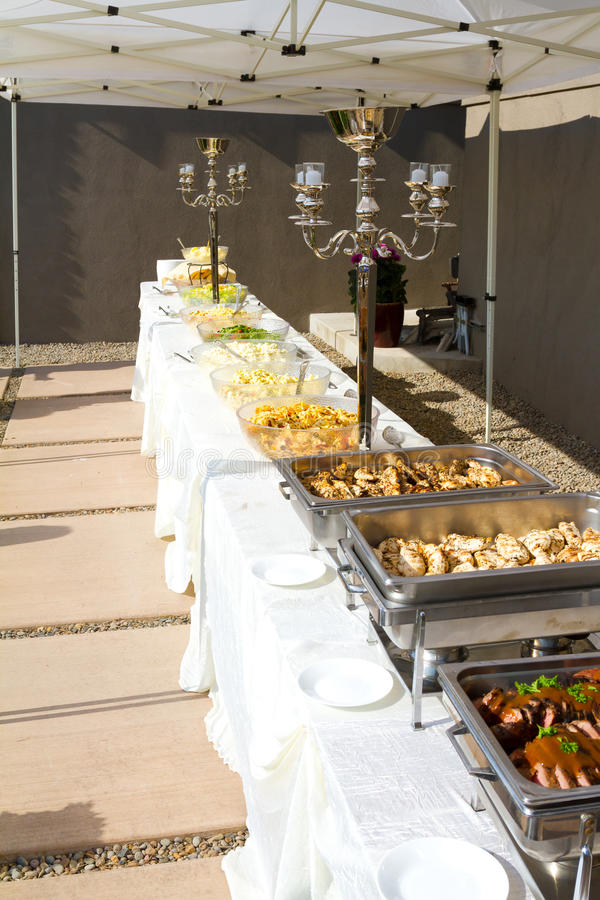 Photo about Reception food at a wedding buffet outdoors under a tent. Image of nutrition