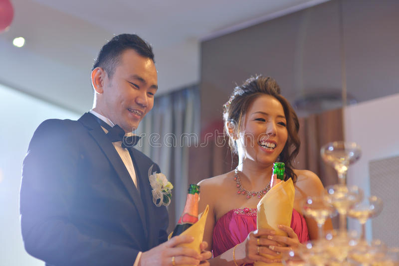 Wedding reception champagne toasting. Happy Asian Chinese wedding dinner reception, bride and groom champagne toasting, natural candid photo stock photos