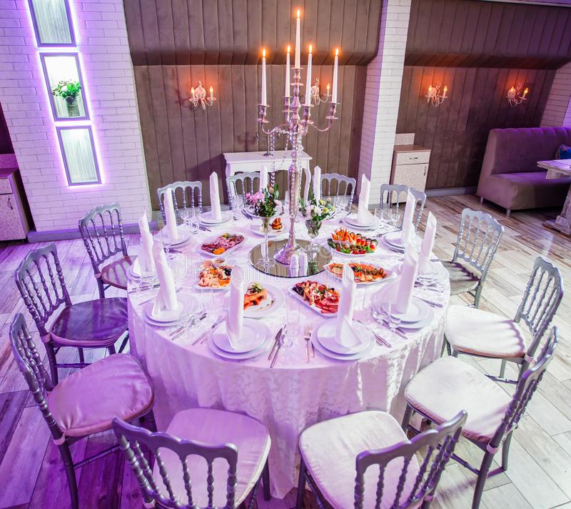 Appetizer Only Wedding Reception: Wedding Reception Dinner. Round Table Served With Flowers