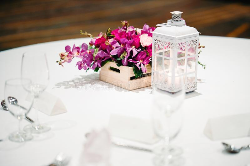 Reception dinner table decoration, orchids, flowers, candles royalty free stock photo